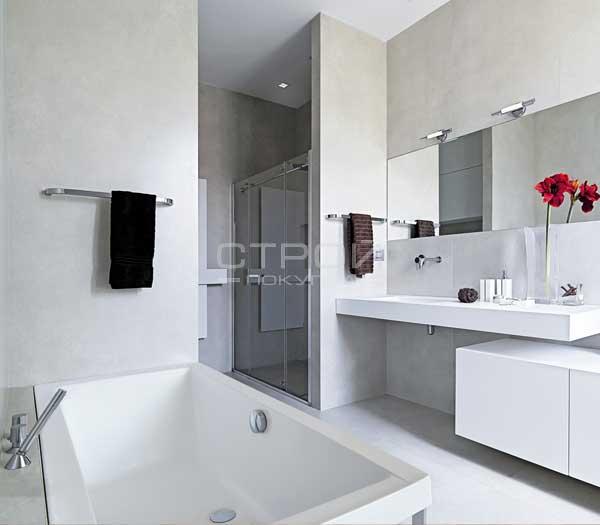 Акриловая ванна Besco Quadro с подголовниками в интерьере комнаты.
