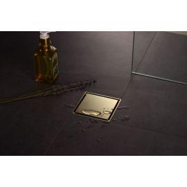 Золотой душевой трап с сухим затвором Magdrain WC 02 Q50-ZW с золотой накладкой в интерьере.