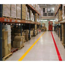 Желтая и красная ленты ПВХ для разметки складских помещений.