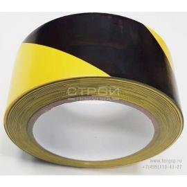 Рулон черно-желтой диагональной сигнальной ленты для разметки.