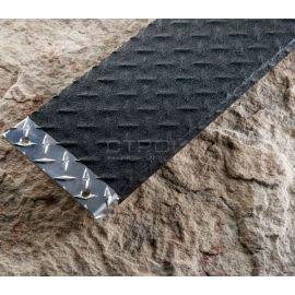 Черная формуемая лента на гофрированном металлическом листе